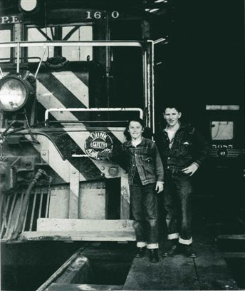 "Rail fan and book publisher Jeff Moreau and his sister Stefanie pose for the camera in 1951 at West Hollywood Shop along with juice jack 1620 and Hollywood car 5085. Stefanie would go on to fame as actress Stefanie Powers. This photo is from the book ""Growing Up With Trains"" from long gone Interurban Press. Photo from the Jeff Moreau collection."