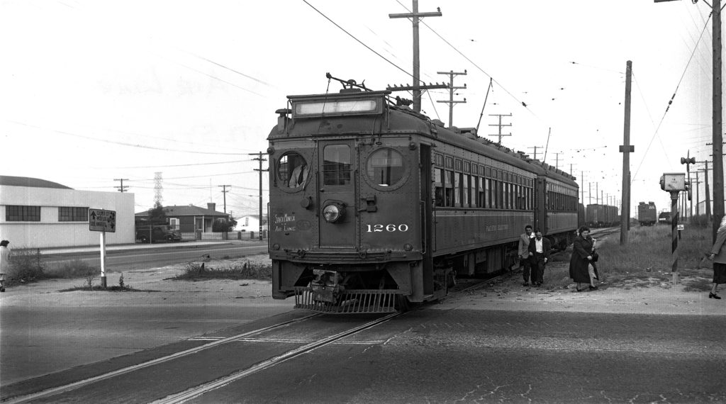 Robert X Loewing photo, Craig Rasmussen collection. Steve Crise Archive Photographer: Robert X Lowing Date: April 1949  Railroad: Pacific Electric Railray Car#: PE 1260 Location: Sentous Yard, La Cienega Blvd at Jefferson Blvd, Los Angeles, California. Present day location of the La Cienega Expo Line station.  Notes on back of 8 x 10 print: 1260 -1227 W.B. on Santa Monica Air Line at Sentous; 1949 (LATL Strike) Rob't X. Loewing Photo. Image notes: Photo taken during the 1949 Los Angeles Transit Lines strike. This explains the use of the 1200's on the Air Line.