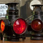 AT&SF marker lamps, kerosene, fitted by the rr with electric lamp holders (ergo no burners). Santa Fe markers typically showed red to the rear and amber to the sides and front. Purchased from a collectables dealer circa 1990. The cords are not original. Generous gift of Gordon Bachlund.