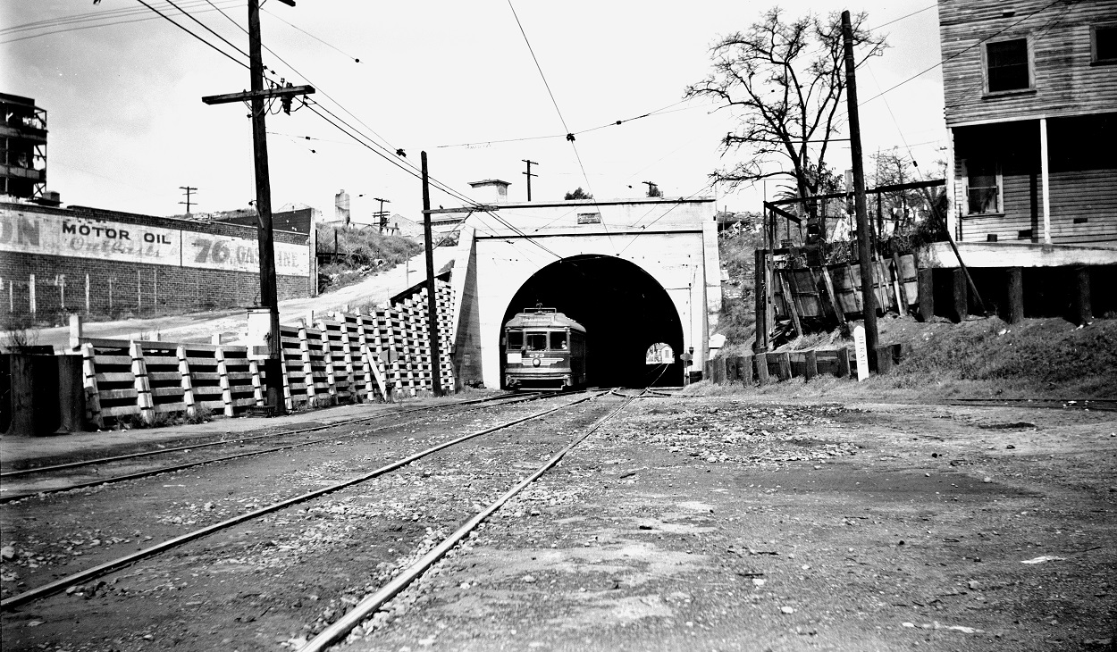 Alan K. Weeks photo. All Rights Reserved. Domino6145@aol.com Photographer: Alan K Weeks Location: Hill Street. Los Angeles, California Date: March 5 1949 Railroad: Pacific Electric Car#: PE 673 Line: Hollywood Blvd Line Filed in Envelope 24 Image Notes: Car 673 PERY Hill St Tunnel Temple St Entrance. Scanned Steve Crise Photo 2014