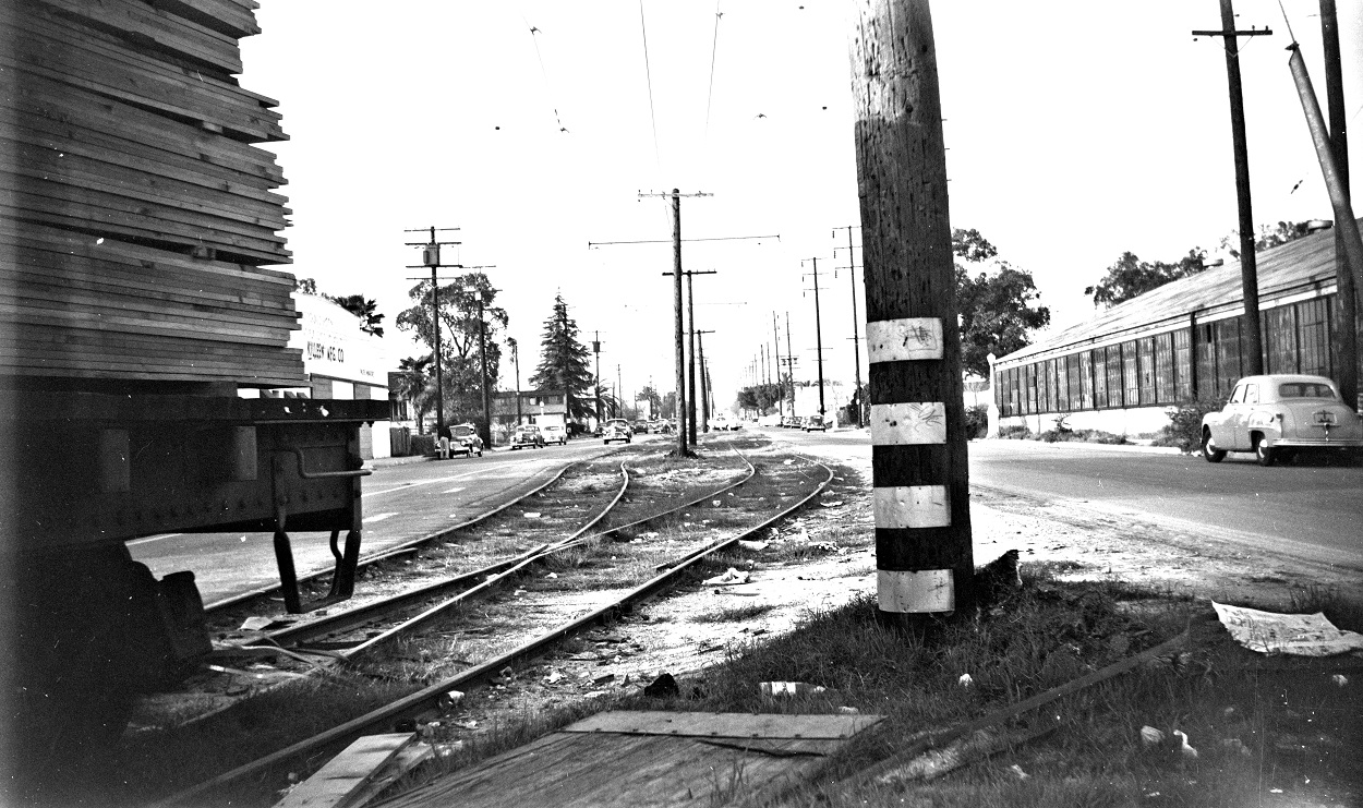 Alan K. Weeks photo. All Rights Reserved. Domino6145@aol.com Photographer: Alan K Weeks Location: Palm Ave, SP Station Branch Line. Plam Ave Looking north from Mission Road. Alhambra, California Date: January 10 1951 Railroad: Pacific Electric Car#: none Line: Whittier Line Filed in Envelope 23 Image Notes: Scanned Steve Crise Photo 2014