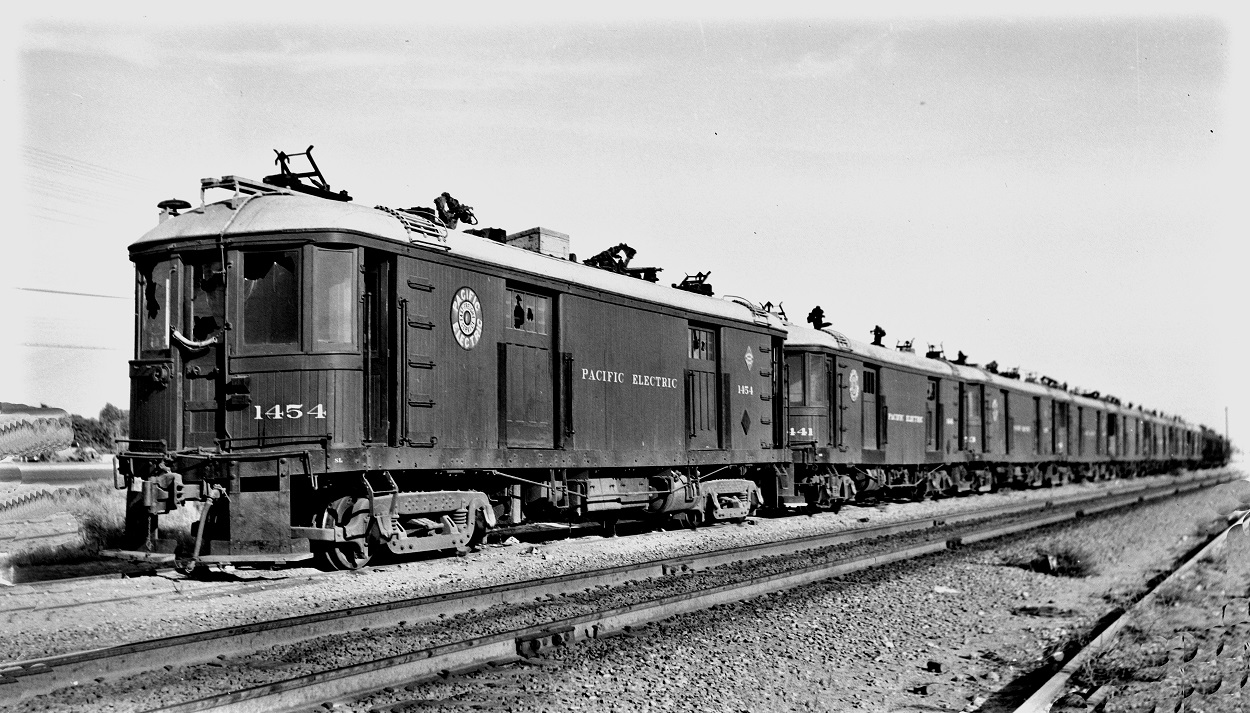 Alan K. Weeks photo. All Rights Reserved. Domino6145@aol.com Photographer: Alan K Weeks Location: Indio, California Date: July 1953 Railroad: Pacific Electric Car#: PE 1454 PE 1441 Line: none Filed in Envelope 25 Image Notes: At Indio on S.P. Railroad Scanned Steve Crise Photo 2014