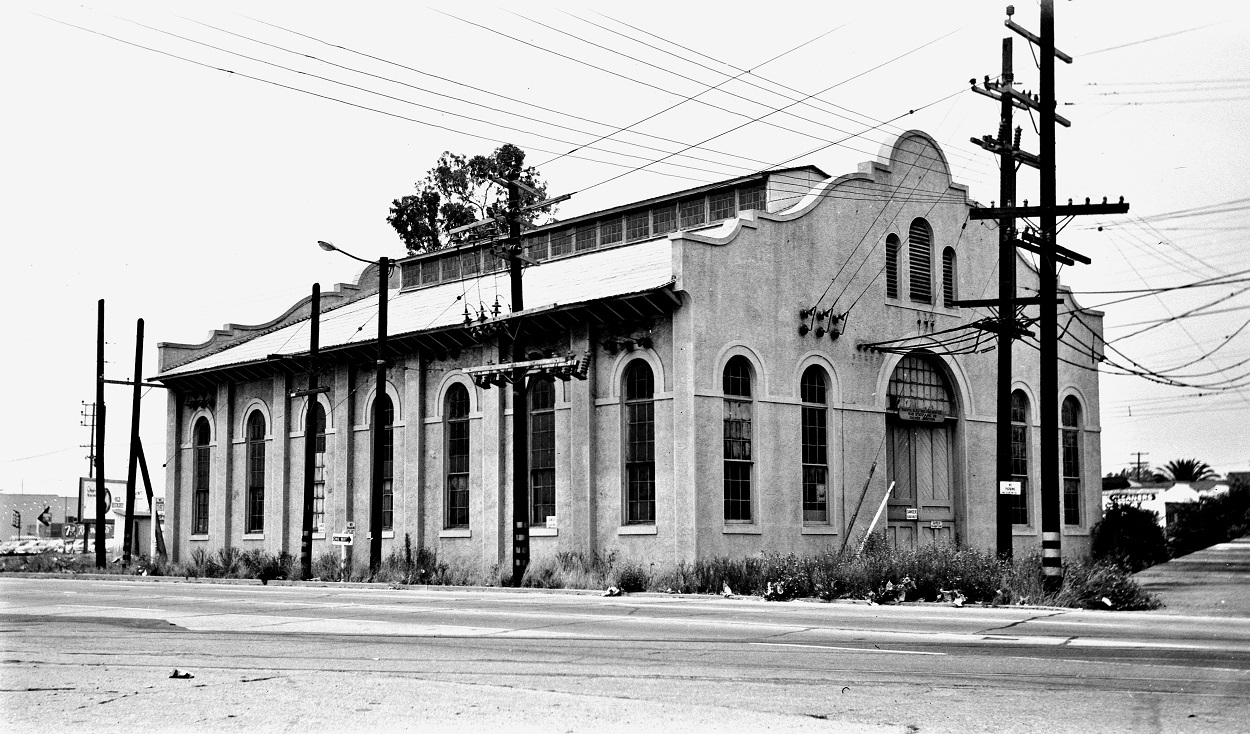 Alan K. Weeks photo. All Rights Reserved. Domino6145@aol.com Photographer: Alan K Weeks Location: Near the intersections of Venice Blvd and Culver Blvd, Culver City, California. Date: July 1954 Railroad: Pacific Electric Car#: PE Culver Sub Station # 38 / Also known as Ivy Sub Station # 38 Line: Venice Short Line. Filed in Envelope 26 Image Notes: Looking at the building from Culver Blvd, looking northwest. Tracks in foreground are the Culver, Playa Del Rey, Redondo Beach Line. Scanned Steve Crise Photo 2014